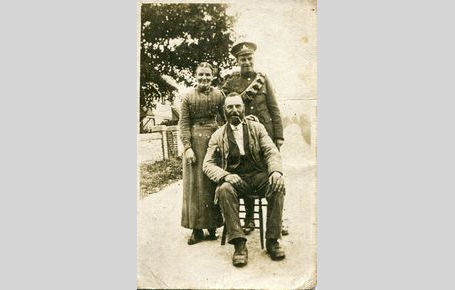 Caroline & William West with son Jessie outside home in the Fridays WW1