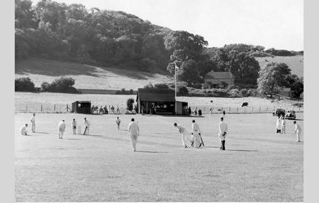 Cricket with old pavilion